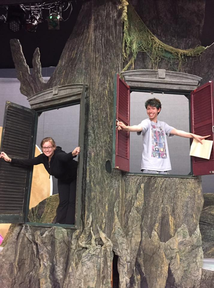Christina and SM Bryan pop out of the windows on the Into The Woods set.